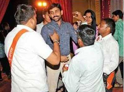 bajrang-dal-activists-purify-non-hindus-at-garba-venues-in-gandhinagar-by-sprinkling-cow